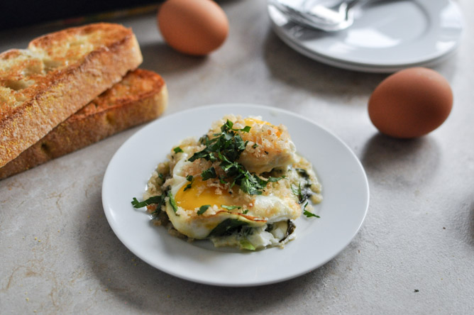 Fontina & Spinach Baked Eggs w/ Garlic Brown Butter Breadcrumbs