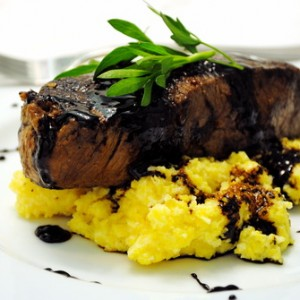 Seared Steak over Soft Polenta w/ a Fig Balsamic Reduction<br>