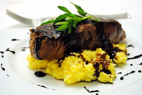 Seared Steak over Soft Polenta w/ a Fig Balsamic Reduction<br>