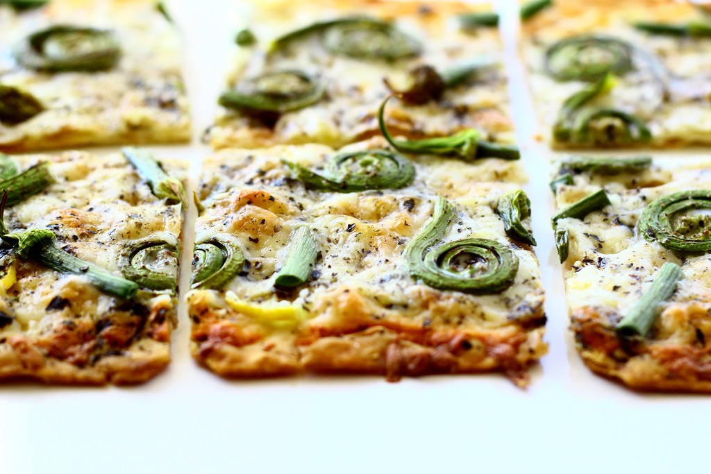 Flatbread with Fiddlehead Ferns, Onion Scapes and Pecorino